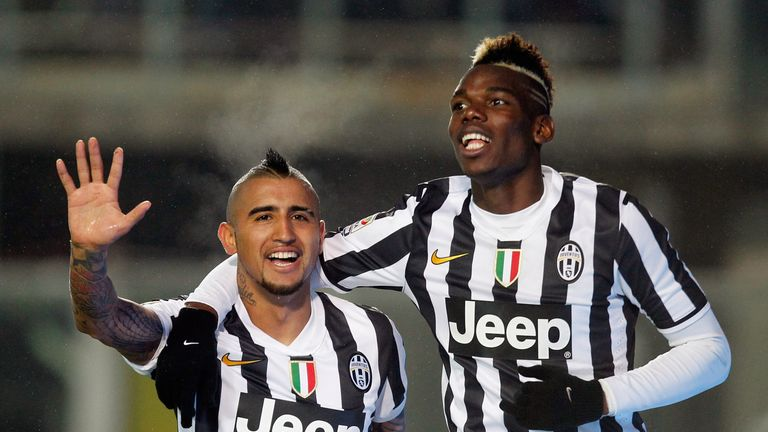 Arturo Vidal (L) and Paul Pogba (R) were brought to Juventus under Conte