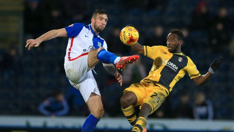 Shane Duffy and Moussa Dembele battle for the ball at Ewood Park
