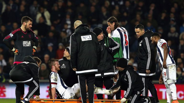 West Brom's Chris Brunt is taken to a stretcher in the first half