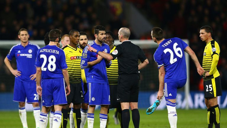 Costa reacts after being booked by referee Dean