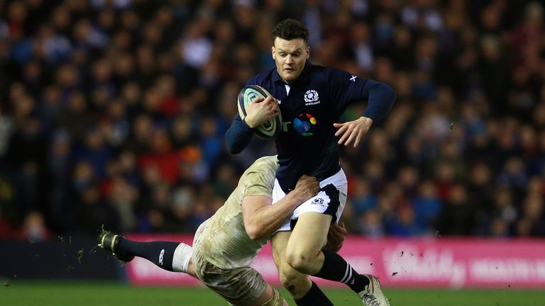 Scotland's Duncan Taylor is tackled by England's George Kruis