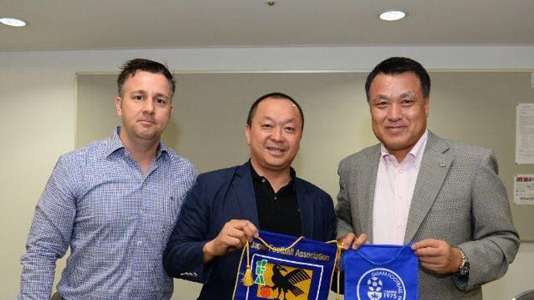 White with Guam's football chief Richard Lai and Kohzo Tashima, president of the Japanese FA