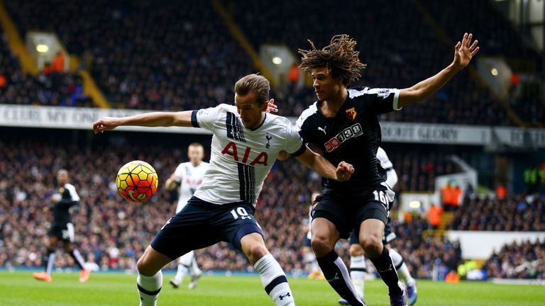 Harry Kane and Nathan Ake (right) compete for the ball