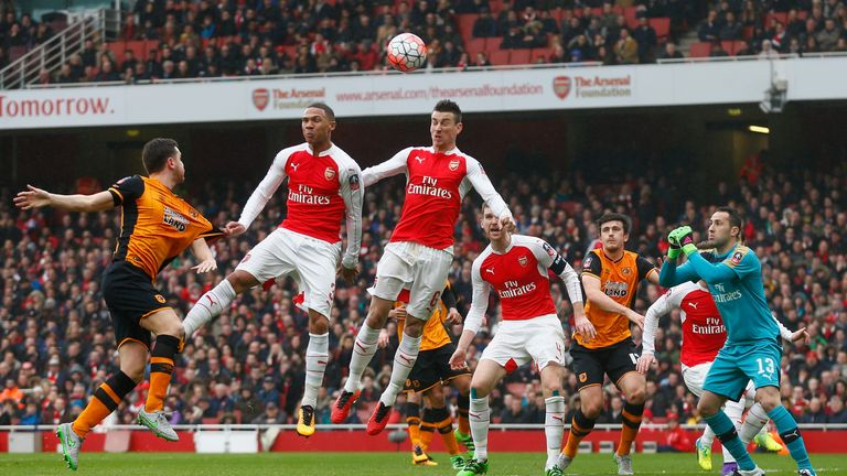 Laurent Koscielny heads away from goal