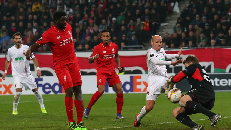 Tobias Werner and Simon Mignolet compete for the ball inside the area