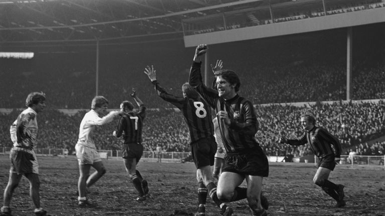 Manchester City's Mike Doyle (front) and his team-mates celebrate Doyle's equaliser