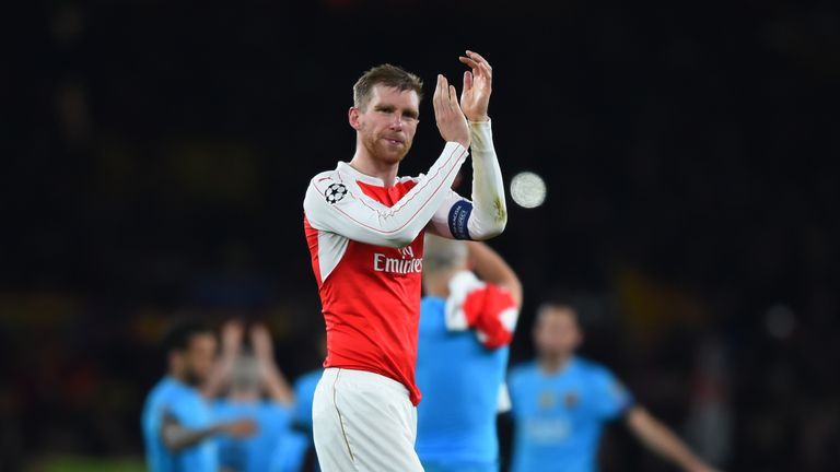 Per Mertesacker has told his team-mates to bounce back against Manchester United.