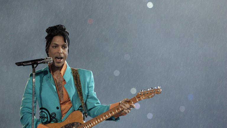 Prince performs Purple Rain in the rain of Miami during half-time of the Super Bowl