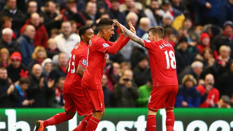 Roberto Firmino (middle) celebrates his opening goal