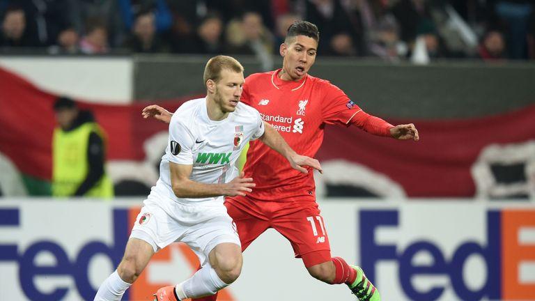 Augsburg's Ragnar Klavan looks to get by Roberto Firmino