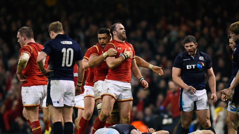 Jamie Roberts is congratulated by Taulupe Faletau after scoring Wales' second try