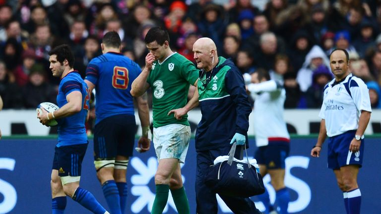 Ireland fly-half Johnny Sexton leaves the pitch due to injury