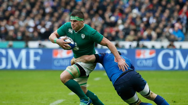 Ireland flanker CJ Stander is tackled by France's Wenceslas Lauret
