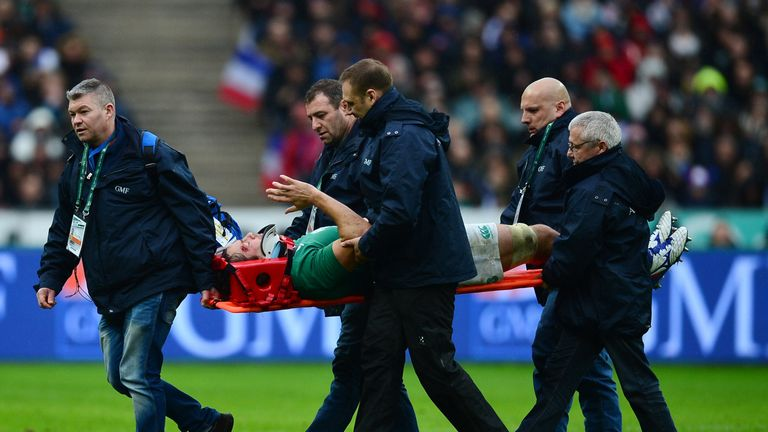 Mike McCarthy is stretchered off the pitch after suffering concussion