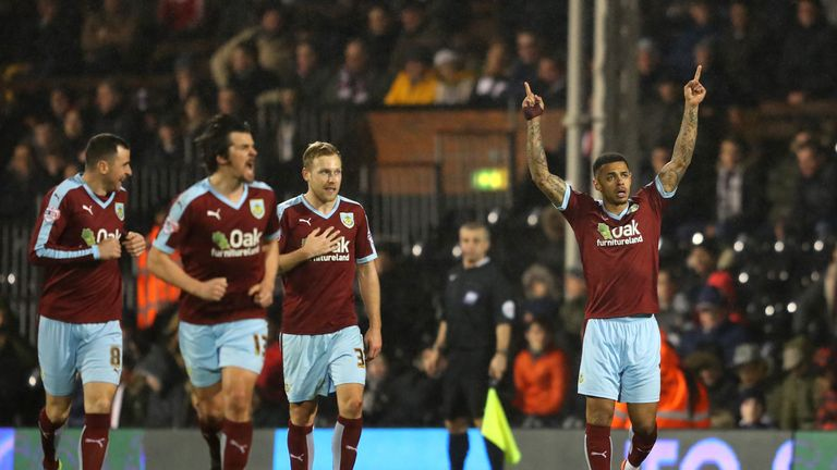 Andre Gray celebrates his winner at Craven Cottage