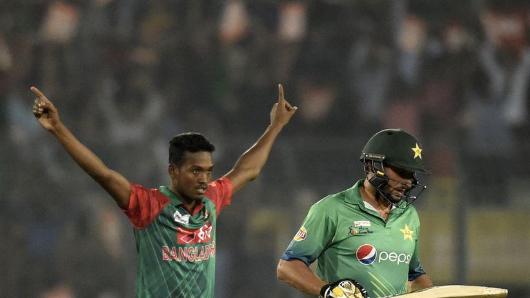 Bangladesh's Al-Amin Hossain reacts after the dismissal of Pakistan cricket captain Shahid Afridi