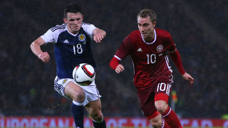 John McGinn (left) against Christian Eriksen in McGinn's debut for Scotland