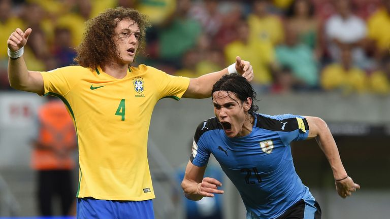 Edinson Cavani (right) scored Uruguay's first goal in Recife