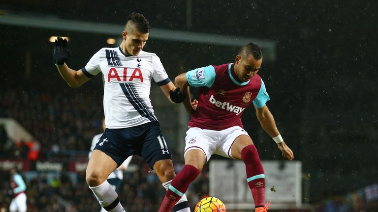Dimitri Payet and Erik Lamela vie for the ball