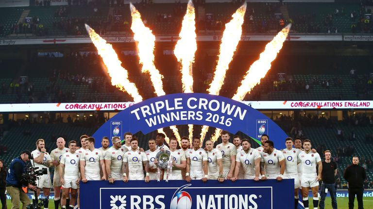 England celebrate their Triple Crown success on the Twickenham pitch