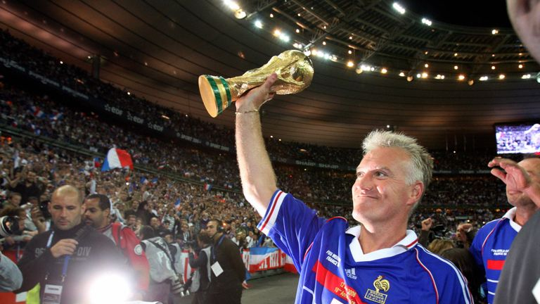 Skipper Deschamps holds the World Cup trophy aloft in 1998