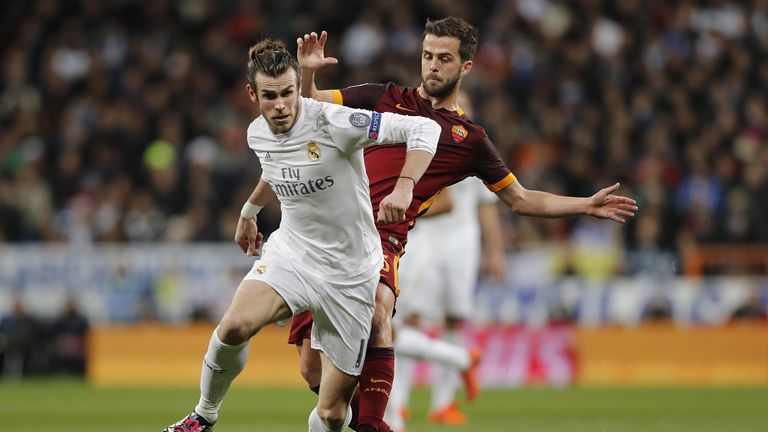 Pjanic trying to win the ball from Gareth Bale