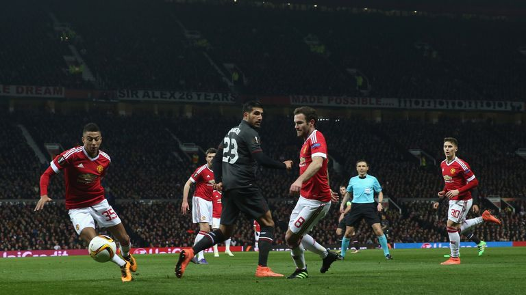 Juan Mata and Jesse Lingard of Manchester United in action with Emre Can