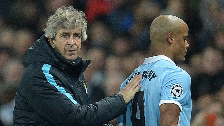 Pellegrini (left) believes Kompany (right) could return earlier than Belgium boss Marc Wilmots expects