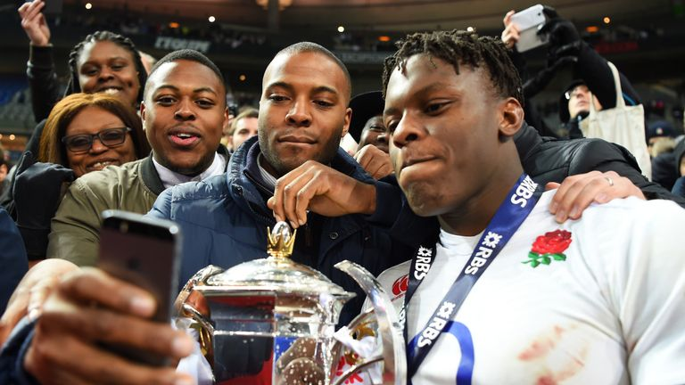 Maro Itoje poses for a picture with the Six Nations trophy