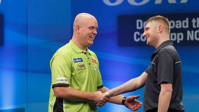 Michael van Gerwen shakes hands with Ryan Harrington after his victory in the UK Open in Minehead on Friday