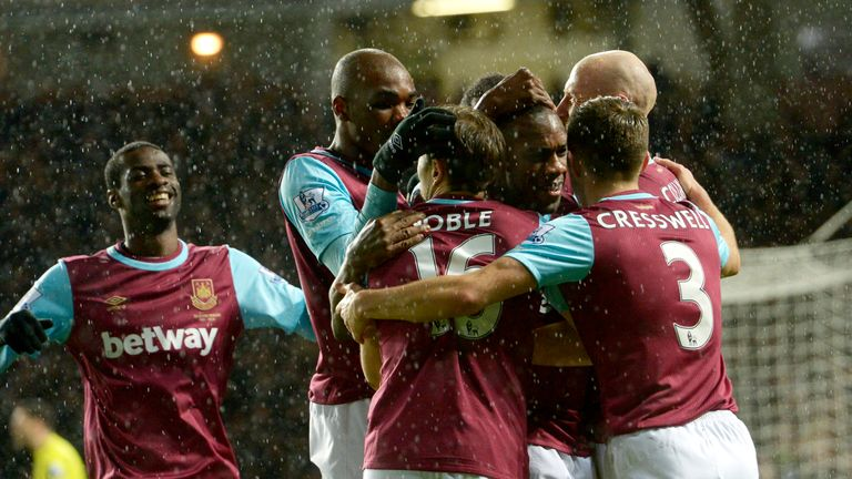 Michail Antonio celebrates with his West Ham team-mates