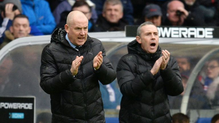 Mark Warburton (left) saw his Rangers side lose three goals for the second consecutive game