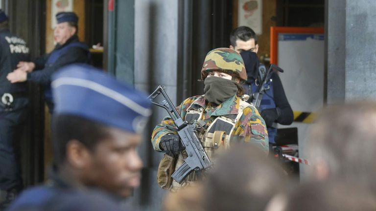 Police and soldiers stand guard following Tuesday's terrorist attacks