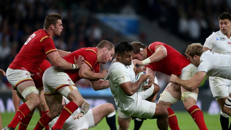 Billy Vunipola is tackled by Gethin Jenkins and Alun Wyn Jones during the World Cup