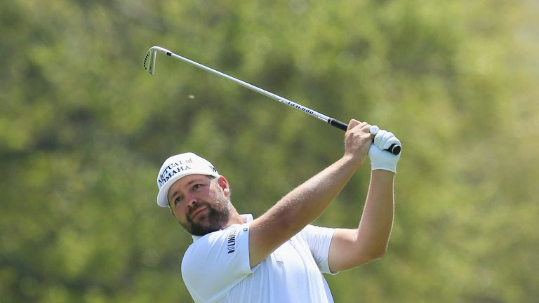 Ryan Moore could not take advantage at 16 after Cabrera-Bello drove into water