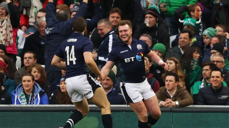 Hogg is congratulated by team-mate Tommy Seymour after scoring against Ireland