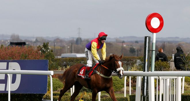 Native River passes the winning post in the Betfred Mildmay Novices' Chase