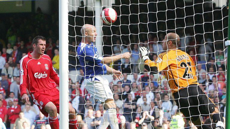 Andy Johnson puts the ball past Liverpool goalkeeper Pepe Reina