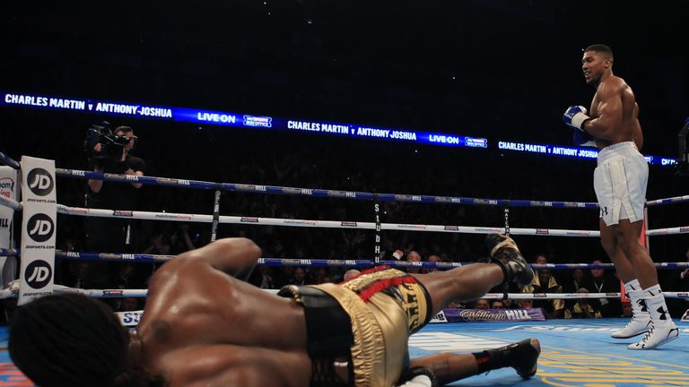 Joshua (right) knocked out Charles Martin to win the IBF heavyweight title