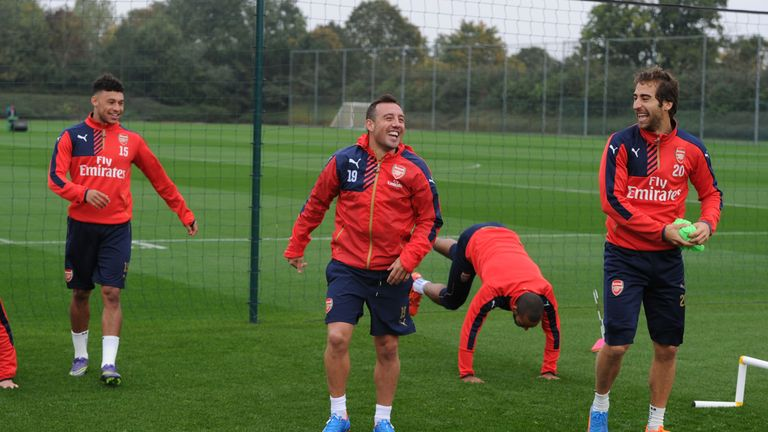 Alex Oxlade-Chamberlain (left) and Santi Cazorla could be training again next week