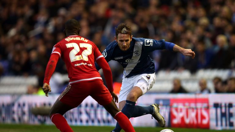 Birmingham City's Jonathan Grounds and Middlesbrough's Albert Adomah battle for the ball