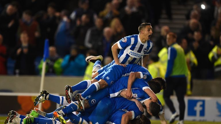Brighton's players celebrate after scoring against QPR