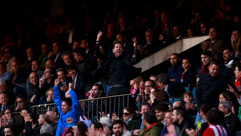 Diego Simeone watched much of Atletico Madrid's win over Malaga from the stand after he was sent off