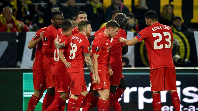 Divock Origi is congratulated after opening the scoring for Liverpool in Dortmund