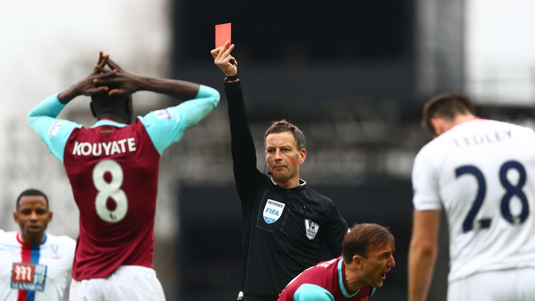 Kouyate of West Ham is shown a red card by referee Mark Clattenburg