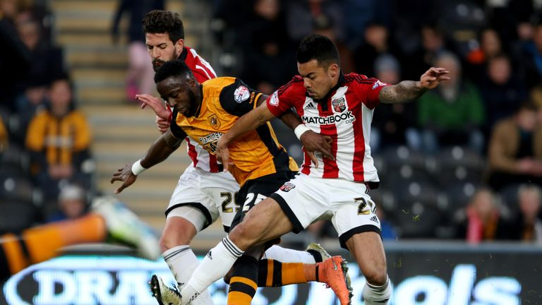Adama Diomande (left) and Josh Clarke challenge for the ball during the Hull victory.