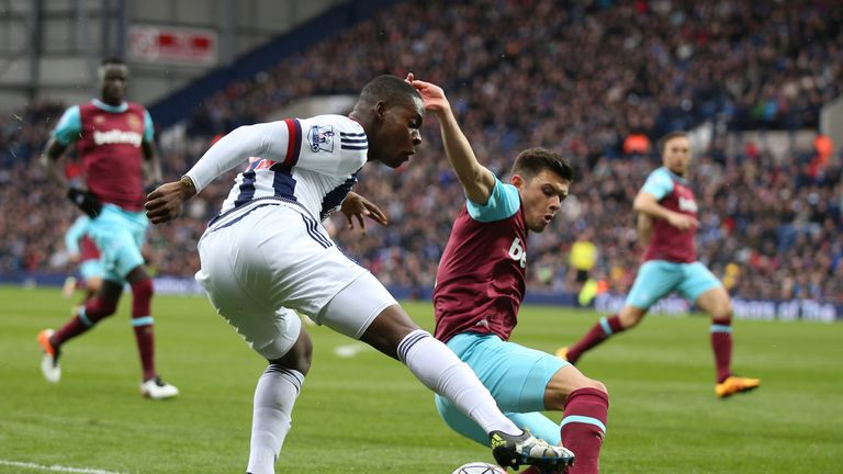 Cresswell is firm in the tackle against West Brom