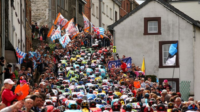 The Peloton climb through the town of Houffalize during the 101st Liege-Bastogne-Liege cycle road race on April 26, 2015 in Lie
