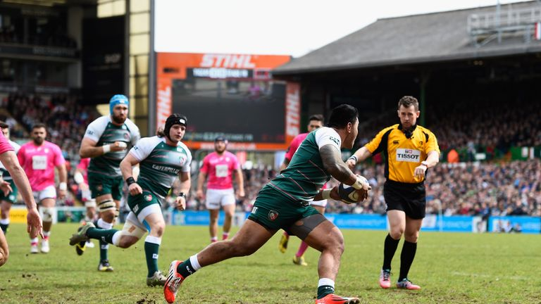 Tigers player Manu Tuilagi runs in the first try watched by referee Nigel Owens
