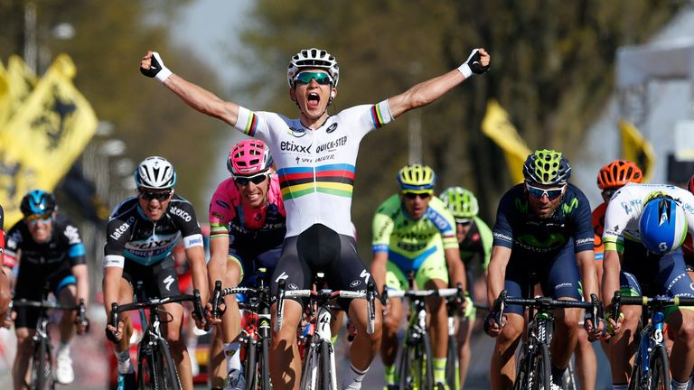 Michal Kwiatkowski celebrates as he crosses the finish line and win the 50th edition of the Amstel Gold race on April